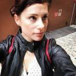 Tawny Sverdlin photo for iNALJ interview, wearing a black jacket